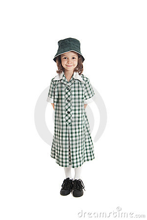 Girl in school uniform and sun hat isolated
