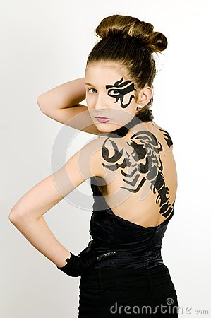 Girl with scorpio painted on back