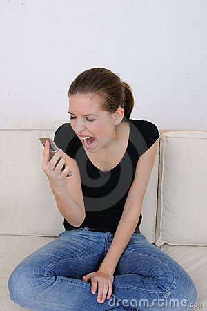 Girl screaming at her cellphone