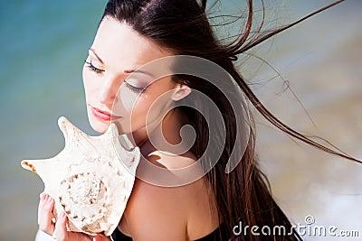 Girl with seashell