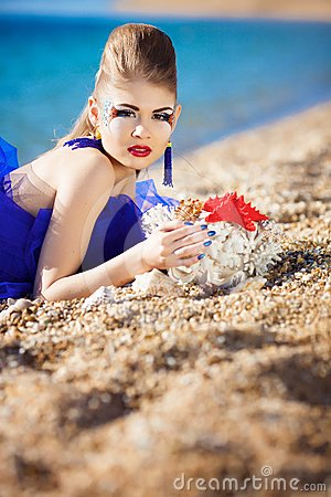 Girl With Seashells On The Beach Stock Photography - Image: 24522452