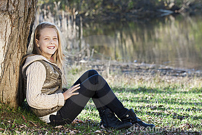 Girl seated in a park