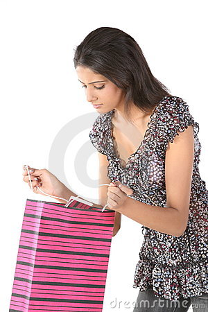 girl seeing the shopping bag with surprise