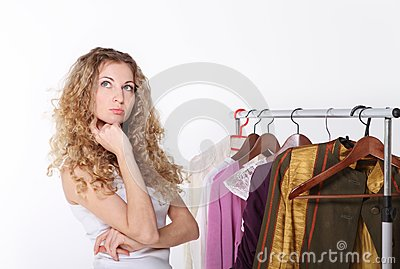 Girl selecting clothes in shop