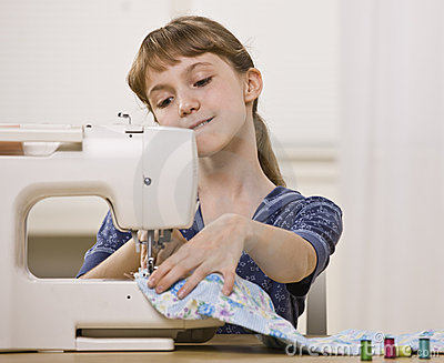Girl on Sewing Machine