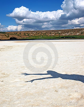 Girl shadow on a salt lake