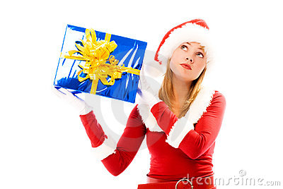 Girl shaking a box with a Christmas present