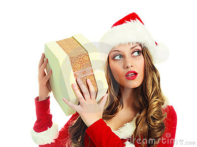 Girl shaking a Christmas present