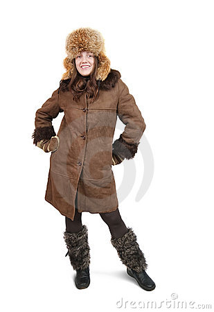 Girl in sheepskin and hat with earflaps