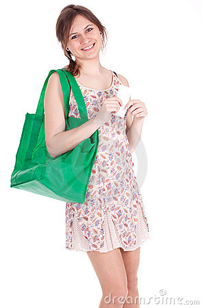 Girl with shopping bag checking purchases list