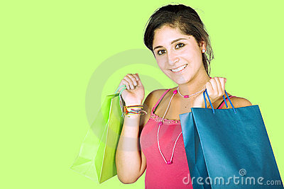 Girl with shopping bags over green