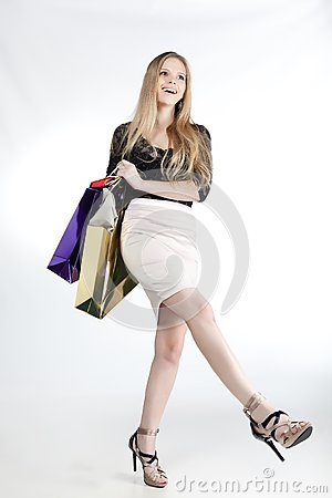 Girl with shopping laughs
