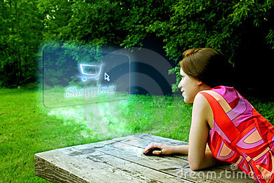 Girl shopping on-line in park