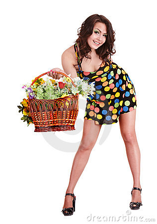 Girl in short dress with basket  spring flower.