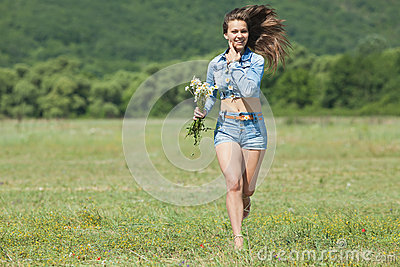 Girl in shorts in field