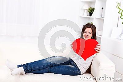 Girl showing big paper heart