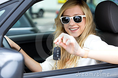 Girl showing car key