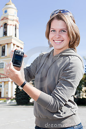Girl showing compact camera screen