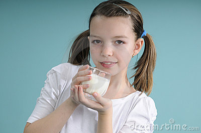 Girl showing glass with milk