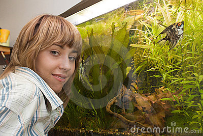 Girl showing her aquarium