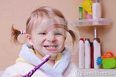 Girl showing her teeth in bathroom