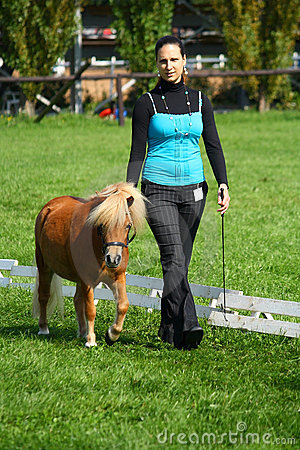 Girl showing a mini pony