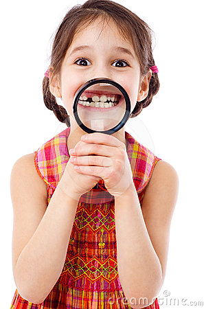 Free Girl Showing Teeth Through A Magnifier Royalty Free Stock Images - 24409519