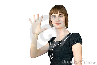The girl shows five fingers