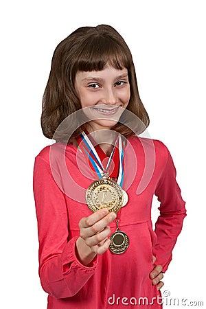 Girl shows gold medal