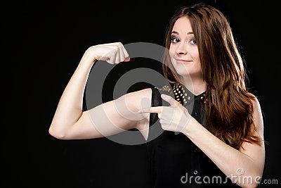Girl shows her muscles strength and power
