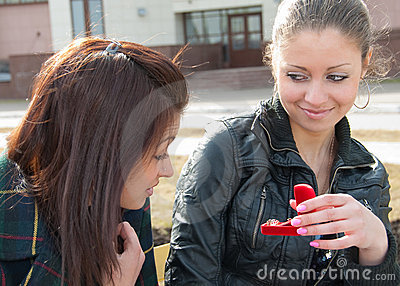 Girl shows to other ring in red box