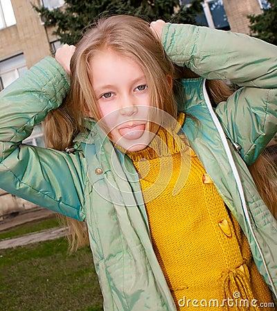 Girl shows tongue