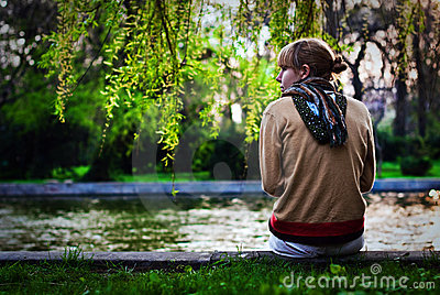 Girl on the side of the river