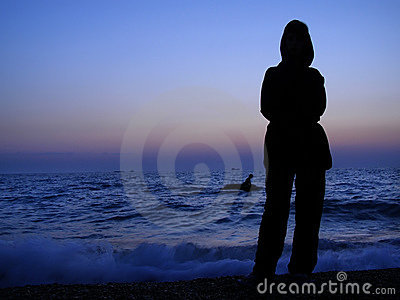 Girl silhouette sea sunset