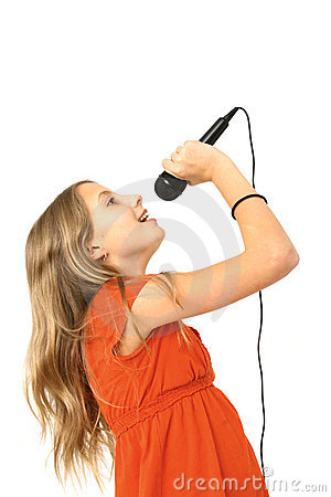 Girl Singing Into Microphone Royalty Free Stock Images