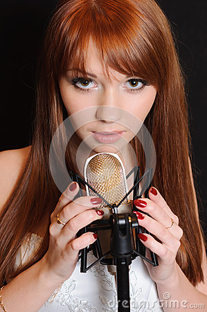 Singing girl in headphones.