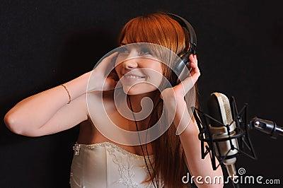 Singing girl in headphones.
