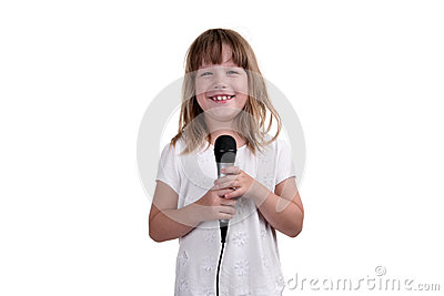 The girl sings with a microphone in hands