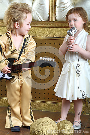 Girl sings a song and pop musician plays guitar