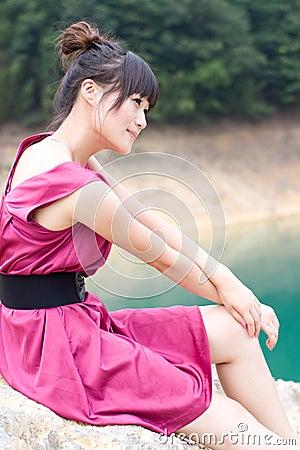 Girl sit at the lake