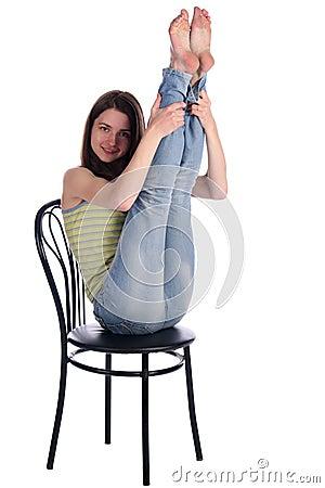Girl sit on stool take legs up.