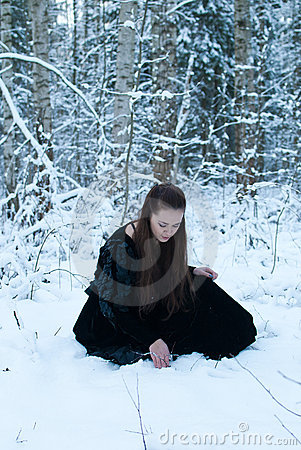 girl sit in winter forest
