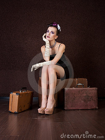 Girl sits on a bag