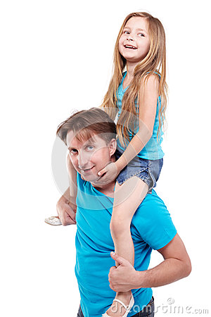Girl sits on father shoulders