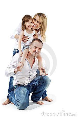 Girl sits on father shoulders, mother supports her Stock Photo