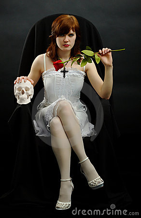 Free Girl Sits In Black Chair With A Rose And Skull Royalty Free Stock Photos - 17869608