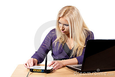 A girl sits at a laptop