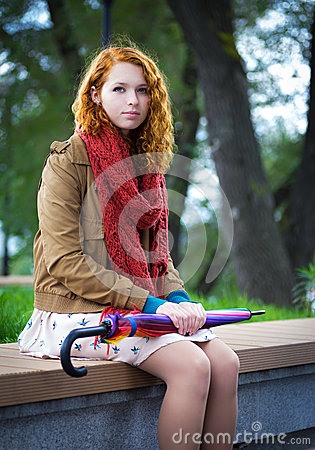 Free Girl Sits On A Bench. Stock Photos - 34816473