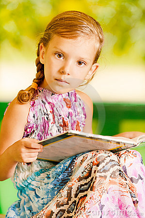 Girl sits reading book