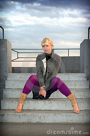 Girl sits on stair